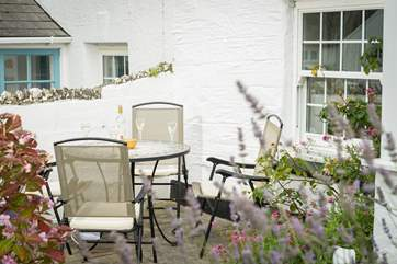 A lovely spot for morning coffee or an evening drink, overlooking the green.