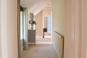 Looking down the hallway from the twin bedroom towards the stairs.