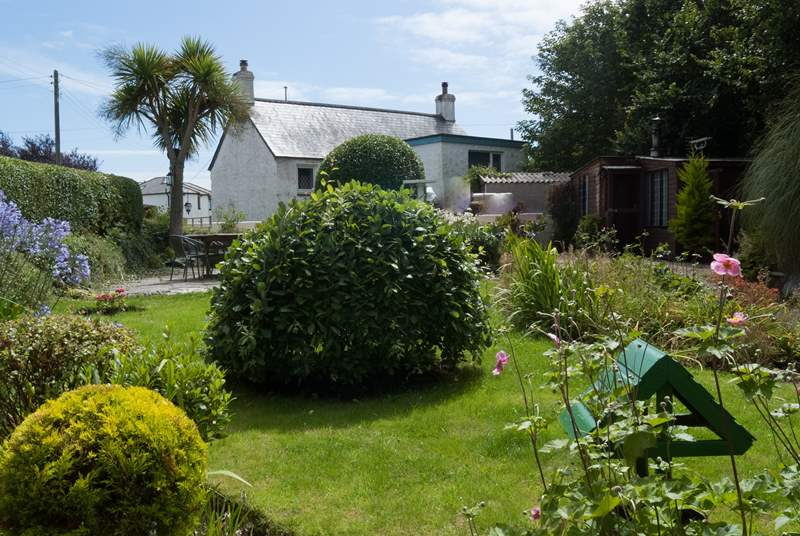 The pretty garden is to the front of the cottage.