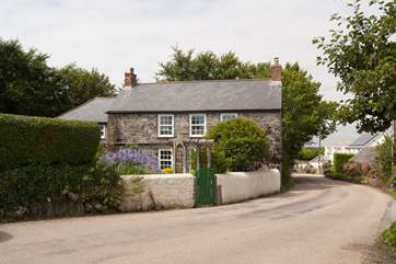 This pretty stone cottage is on the lane that takes you through the village, there is a 30mph restriction and the cottage has double-glazing.