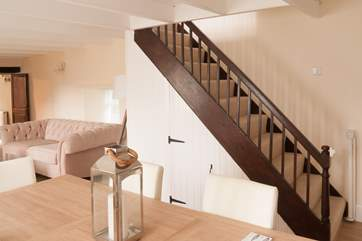 Stairs up to the first floor bedrooms and bath/shower rooms, there is stair-gate at the bottom of the staircase.
