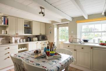 The country cottage kitchen with the door opening to the front and onto the driveway and garden.