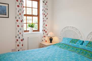 The second good sized bedroom is bright and perfect for couples or the children in your family