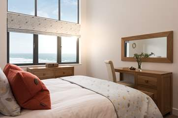 The main bedroom shares the views over the sea at Praa Sands and across the dunes to the beach below.
