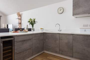A fabulous kitchen with everything you need including a wine fridge!