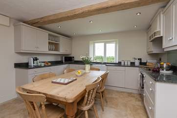 This is the brand new main kitchen with a welcoming farmhouse kitchen table perhaps for children to eat at whilst parents are cooking - there is also a proper dining room.