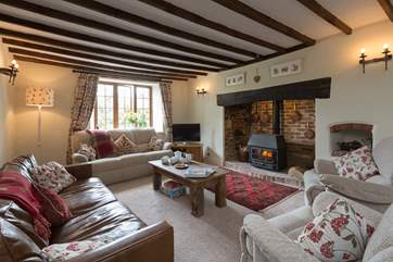 There is a large but very cosy farmhouse sitting-room to come back to after a lovely day out exploring. There is a comfy chair in the second kitchen/dining room that can be brought into this room for