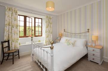 This is bedroom 4. A lovely double bedroom with a classic iron-framed bed.