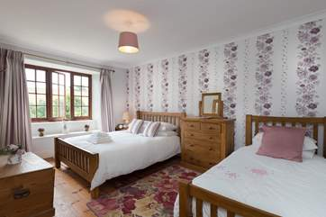 This is bedroom 1. A great family room with views over the garden and across the valley.