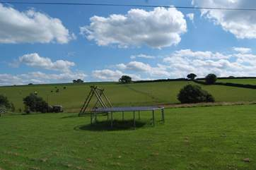 The cottage looks out at this view!  A wonderful  field with picnic tables and a barbecue for you to make the most of