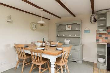 There is a farmhouse dining-table in one corner - in the meadow outside there are picnic tables for eating al fresco or for having a barbecue.