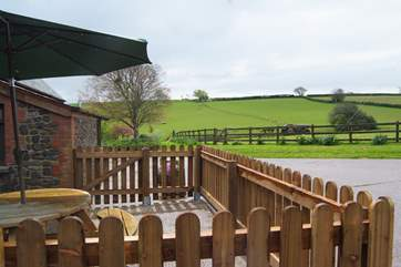 Oak Cottage has a fully fenced patio area with views across the fields.