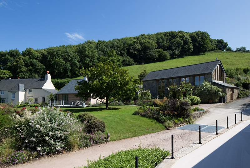 Looking back across at Little Coombe Cottage, Little Coombe Barn and the owner's main house. Both properties would prove an amazing set-up for a larger group holiday.