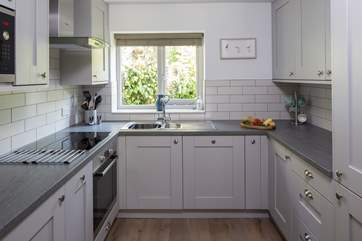 Compact yet fully equipped kitchen with all the mod-cons, making cooking in Little Coombe Cottage a pleasure.
