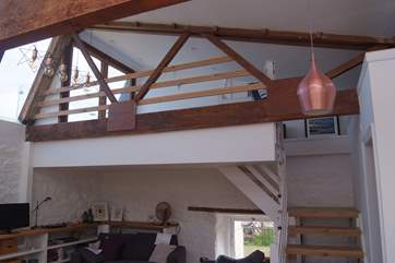 There are open tread stairs up to the galleried bedroom.  This overlooks the ground floor living-area.