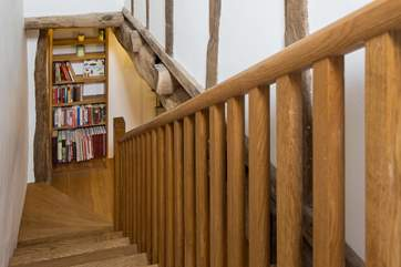 Beautiful staircase takes you to the first floor bedrooms.