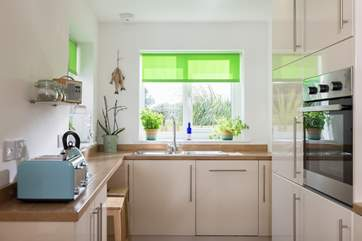 The kitchen has windows to both front and rear making the room really light.
