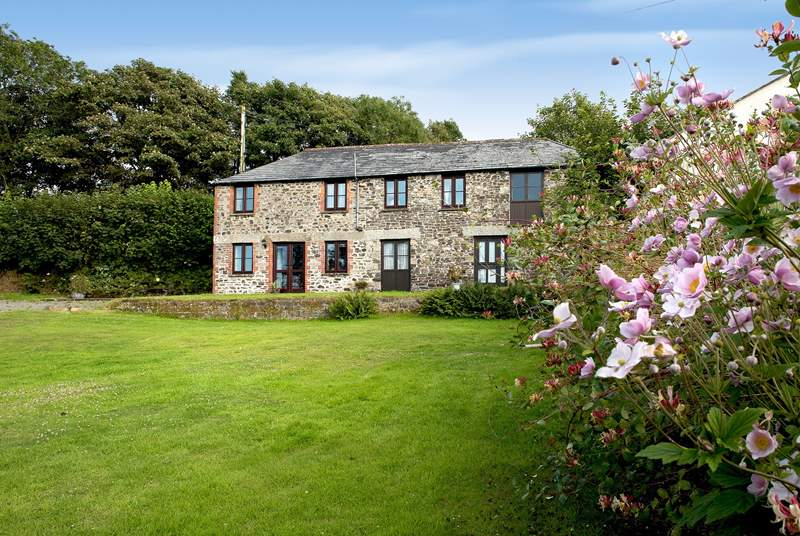 Coombe Cottage is located on the right-hand side and has its own private entrance and garden at the back.