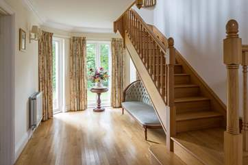 The stairs lead off this grand hallway. The hallway is a splendid area in its own right.