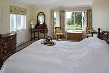 Bedroom 2 boasts the most breathtaking views out over these stunning grounds.