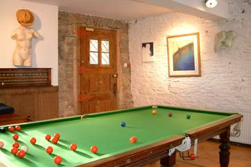 Snooker table within the shared games-area.