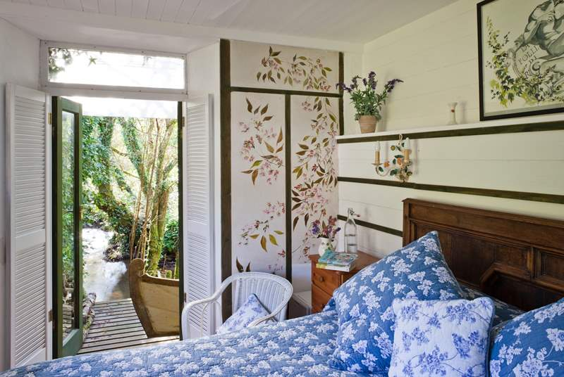 The gorgeous king-size bedroom which leads out onto the lower deck-area.
