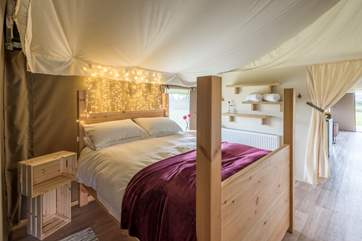 The pretty double bedroom, with king-size bed, is situated towards the back of the tent.
