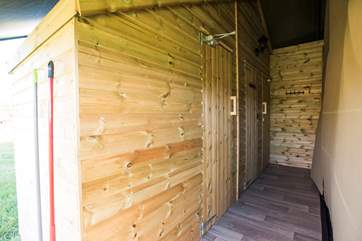 This is the corridor to the shower-room and cloakroom, accessed from inside or outside the tent.