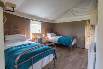 The lovely twin bedroom is located towards the back of the tent.