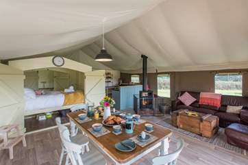 A wonderful family retreat with three separate bedroom areas, one is the great fun enclosed cabin seen here, then there is a double and a twin bedroom towards the back of the tent.