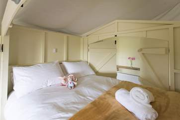 The king-size cabin bed is super cute and cosy.