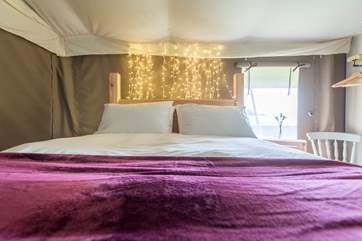 The pretty king-size bedroom is set towards the back of the tent.