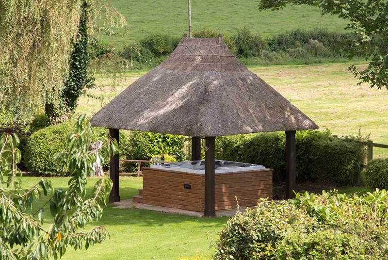 The hot tub in its pretty thatched pergola is a wonderful treat here.