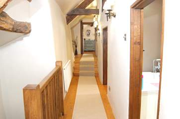 As this is an historic Devon Longhouse, four bedrooms and a family bathroom are all off this first floor corridor. The far end bedroom has its own en suite.