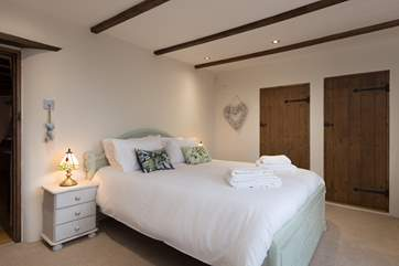 This is the ground floor bedroom with en suite facilities, a separate shower-room and WC.