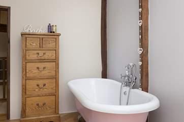 The family bathroom has a stunning roll top bath.