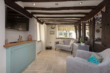 This snug is right next to the kitchen so is an ideal place for children whilst you cook up a treat.