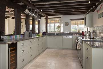 There is a stunning bespoke kitchen with a brand new range cooker.