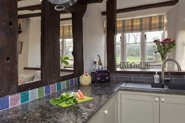 The kitchen area links to the snug through these ancient structural beams.