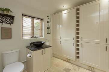 The downstairs cloakroom also houses a super size fridge/freezer as well as additional storage.