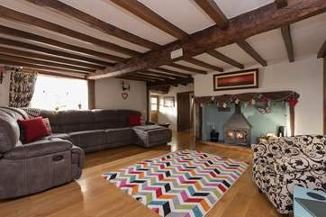 This is the main living-room with its wonderful wood-burning stove.