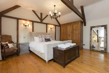 The master bedroom with its super-king sized bed is a real statement.