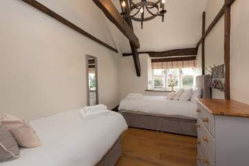 There are views over the gardens from this bedroom.