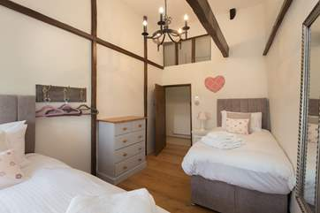 This is the twin bedroom - it also has amazing high ceilings and beams to really celebrate the character of this historic property.