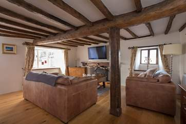 Another view of the second living-room, the beams give you a taste of the wonderful character of this historic farmhouse.