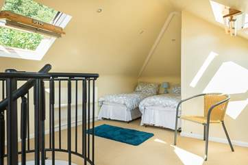 A spiral staircase leads up to Bedroom 4, which has three single beds (great dorm room for older children!).