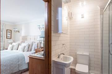 The bright, white, contemporary shower-room.