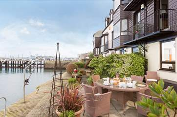 The waterside terrace is ideal for breakfast.