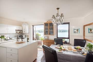 The kitchen/dining-room overlooks the water.