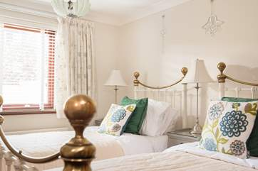 Bedroom 1 has lovely Victorian bedsteads.